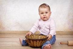 Little toddler with marble form and rolling pin Stock Image