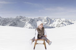 Little toddler outdoors in the snow in the alps Royalty Free Stock Photos