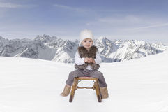 Little toddler outdoors in the snow in the alps Stock Photo