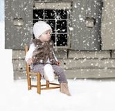 Little toddler outdoors in the snow Royalty Free Stock Photography