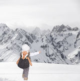 Little toddler outdoors in the snow in thealps Stock Photos