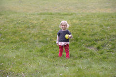 Little toddler playing in the garden Royalty Free Stock Photo