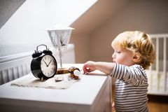 Toddler boy in a dangerous situation at home. Little toddler playing with pills. Domestic accident. Dangerous situation at home stock images