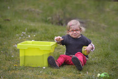 Little toddler playing with sand in the garden Stock Photo