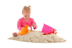 Little toddler playing in the sand Stock Photos