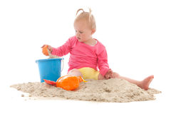 Little toddler playing in the sand Royalty Free Stock Images
