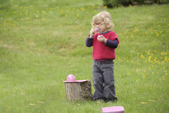Little toddler playing  tea time outdoors in the garden Royalty Free Stock Photos