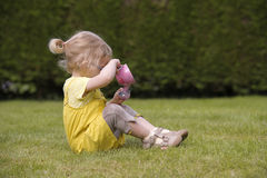 Little toddler playing  tea time outdoors Royalty Free Stock Images
