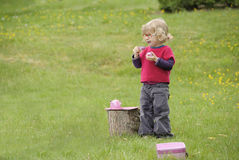 Little toddler playing  tea time outdoors in the garden Stock Images