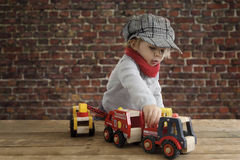 Little toddler playing with wooden cars Stock Photos