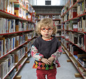 Little toddler in a public library Royalty Free Stock Images