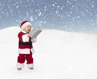 Little toddler santa claus with christmas gift Royalty Free Stock Photos