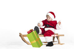 Little toddler in santa claus outfit in the snow Stock Photos