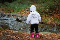 Little Toddler Standing by the Creek Royalty Free Stock Image