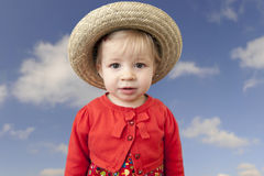 Little toddler with summer straw hat Stock Photography