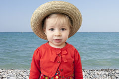 Little toddler with summer straw hat Stock Photos
