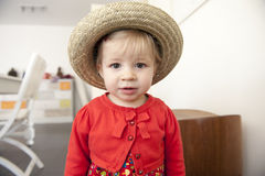 Little toddler with summer straw hat Royalty Free Stock Image