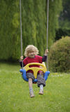 Little toddler on a swing Stock Images