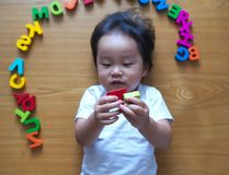 Little toddler top down view with her toys. Little toddler top down view with her alphabet toys Stock Photos
