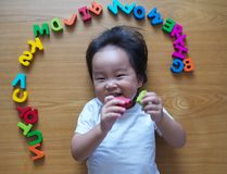 Little toddler top down view with her toys. Little toddler top down view with her alphabet toys Stock Image