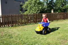 Little toddler with truck spring season royalty free stock photography