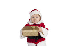 Little toddler in xmas outfit giving a present Royalty Free Stock Image