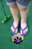Little toes and miniature golf Royalty Free Stock Photo