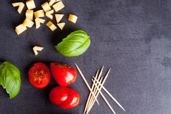 Little tomato, cheese and basil Stock Photography