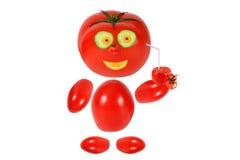 Little tomato  smiles and keeps tomato juice Royalty Free Stock Image