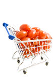 Little tomatoes in shopping trolley. Little fresh tomatoes in shopping trolley isolated over white Stock Photography