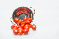 Little tomatoes in white background. Little red tomatoes in white background royalty free stock photo