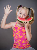 Little toothless girl. Eating  watermelon Stock Images