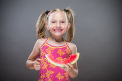 Little toothless girl. Eating  watermelon Stock Photo