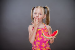 Little toothless girl. Eating  watermelon Royalty Free Stock Images