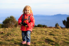 Little tourist with binoculars travel hiking in Stock Photography