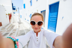 Little tourist girl taking selfie in Greece Stock Photos