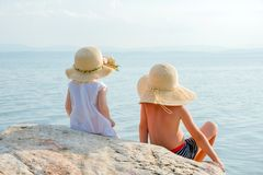 Little tourists near the sea. Vacation with children. Sunny summer days. Children on the seashore. Beautiful children royalty free stock image