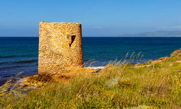 Little tower on the coast. A little tower un the coast of sardinia in spring Royalty Free Stock Photos
