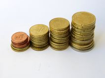 Little towers of sorted euro cents money with white backround royalty free stock images