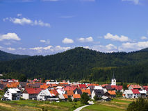 Little town in mountains. Sweet little town under the hill with sky Stock Images