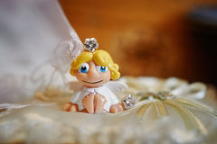 Little toy Angel on a pillow for wedding rings Stock Photo