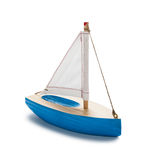 Little Toy Boat. Blue toy sailboat, isolated on white royalty free stock photography