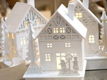 Little toy Christmas houses with vintage lamp posts. R Royalty Free Stock Images