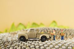 Toy pickup truck. A little toy farm pickup truck and farmers on sunflower seeds Royalty Free Stock Photos