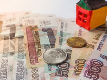 A little toy house concept in the Russian rubles. The concept of savings and aspirations. Royalty Free Stock Photos