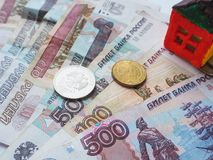 A little toy house concept in the Russian rubles. The concept of savings and aspirations. Royalty Free Stock Image