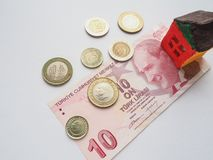 A little toy house concept in the Turkish Lira. The concept of savings and aspirations. Royalty Free Stock Images