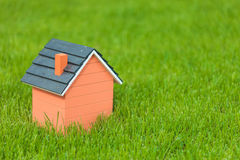 Little toy house in the grass Royalty Free Stock Photography