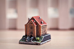 Little toy house on a wooden background Royalty Free Stock Photography