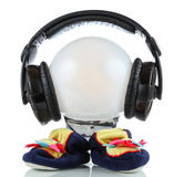 Little toy martian with headphones Royalty Free Stock Photos